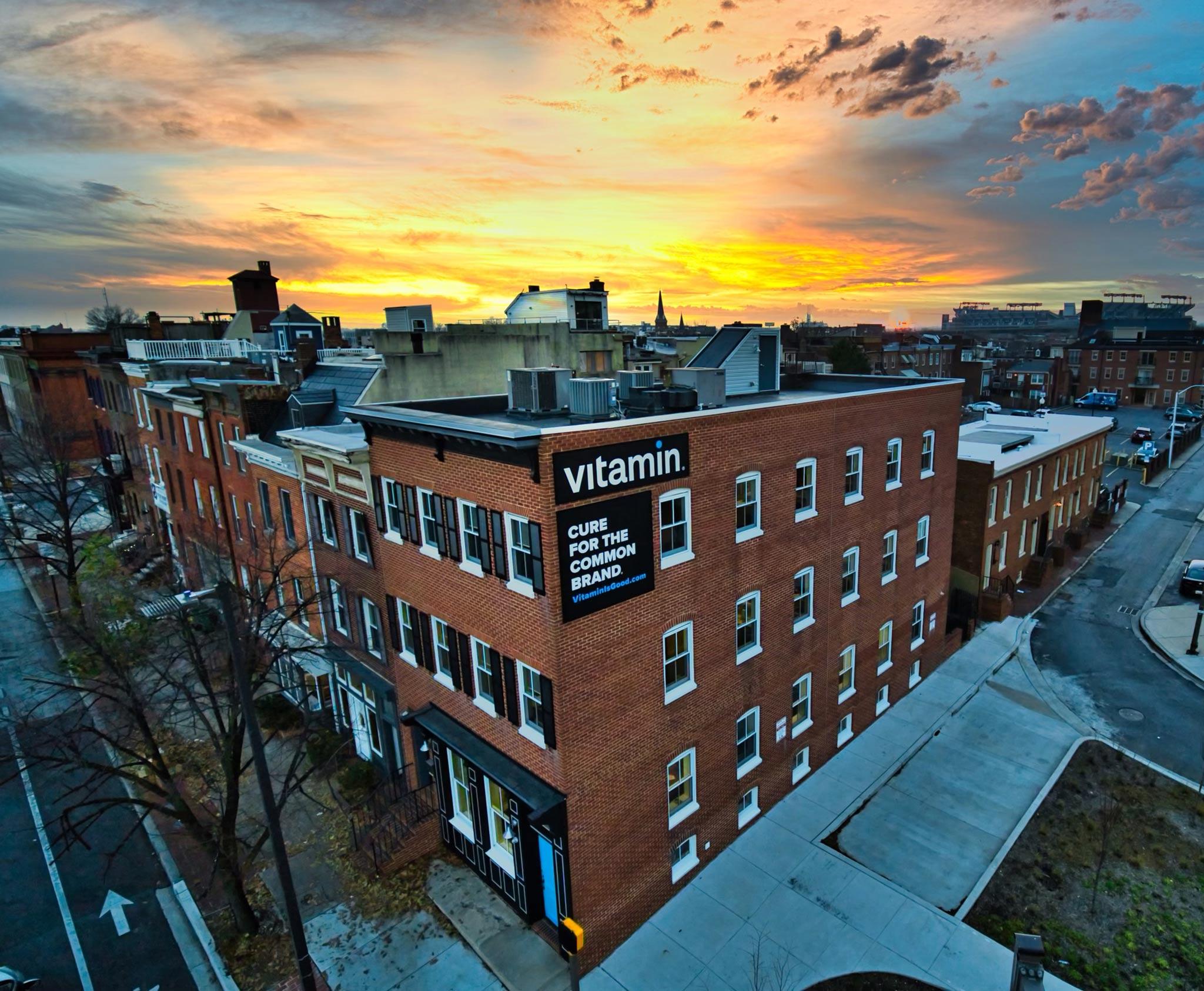 POV photo of Vitamin building at sunset